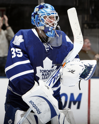 TORONTO, CANADA - FEBRUARY 1:  Jean-Sebastien Giguere #35 of the Toronto Maple Leafs celebrates after stopping Christopher Higgins #21 of the Florida Panthers to win the shootout at the Air Canada Centre February 1, 2011 in Toronto, Ontario, Canada. (Phot