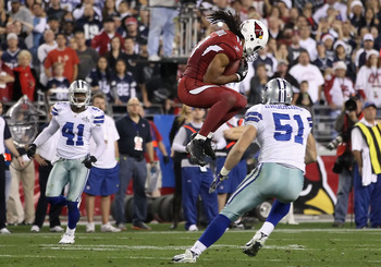 GLENDALE, AZ - DECEMBER 25:  Wide receiver Larry Fitzgerald #11 of the Arizona Cardinals makes a leaping 26 yard reception on fourth down during the fourth quarter of the NFL game against the Dallas Cowboys at the University of Phoenix Stadium on December