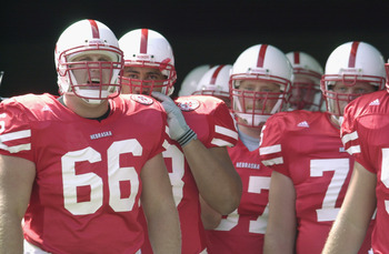 LINCOLN, NEBRASKA - AUGUST 25:  Offensive lineman Jon Rutherford #66 of the Nebraska Cornhuskers stands with his teammates before the NCAA football game against the Texas Christian University Horned Frogs on August 25, 2001 at Municipal Stadium in Lincoln