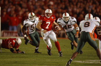 3 Jan 2002:  Quarterback Eric Crouch #7 of Nebraska scrambles against the defense of Howard Clark #45 and Jonathan Vilna #51 of Miami during the Rose Bowl National Championship game at the Rose Bowl in Pasadena, California.  Miami won the game 37-14, winn