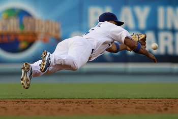LOS ANGELES - JULY 5: Shortstop Rafael Furcal #15 of the Los Angeles Dodgers makes a diving stop against the Florida Marlins on July 5, 2010 at Dodger Stadium in Los Angeles, California.  (Photo by Stephen Dunn/Getty Images)
