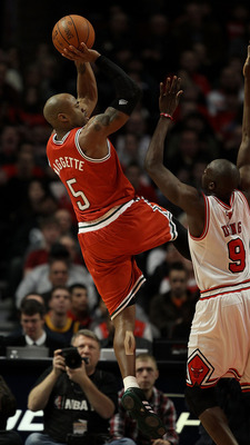 CHICAGO, IL - DECEMBER 28: Corey Maggette #5 of the Milwaukee Bucks puts up a shot over Loul Deng #9 of the Chicago Bulls at the United Center on December 28, 2010 in Chicago, Illinois. NOTE TO USER: User expressly acknowledges and agrees that, by downloa