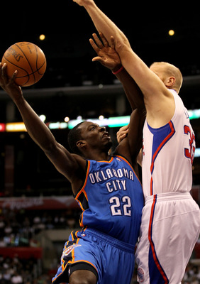 LOS ANGELES, CA - NOVEMBER 03:  Jeff Green #22 of the Oklahoma City Thunder shoots over Chris Kaman #35 of the Los Angeles Clippers at Staples Center on November 3, 2010 in Los Angeles, California.  NOTE TO USER: User expressly acknowledges and agrees tha