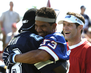 Buffalo Bills wide receiver Andre Reed hugs Dallas Cowboys wide receiver Michael Irvin during  a flag-football legends  game during 2005 Pro Bowl week in Ko Olina, Honolulu February 11, 2005.  (Photo by Al Messerschmidt/Getty Images)