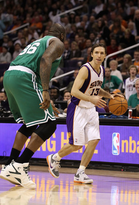 PHOENIX, AZ - JANUARY 28:  Steve Nash #13 of the Phoenix Suns handles the ball during the NBA game against the Boston Celtics at US Airways Center on January 28, 2011 in Phoenix, Arizona.  The Suns defeated the Celtics 88-71.  NOTE TO USER: User expressly