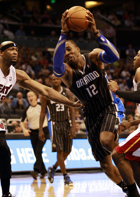 ORLANDO, FL - FEBRUARY 03:  Center Dwight Howard #12 of the Orlando Magic drives against the Miami Heat at Amway Arena on February 3, 2011 in Orlando, Florida. NOTE TO USER: User expressly acknowledges and agrees that, by downloading and or using this pho