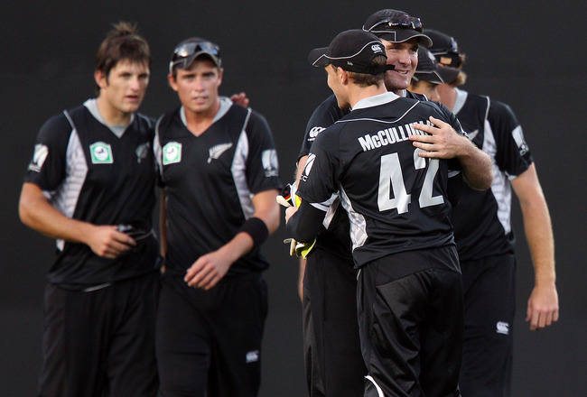 AUCKLAND, NEW ZEALAND - FEBRUARY 05:  L to R, Hamish Bennett, Tim Southee, Brendon McCullum and Jamie How of the Black Caps celebrate thier win during game six of the one day series between New Zealand and Pakistan at Eden Park on February 5, 2011 in Auck