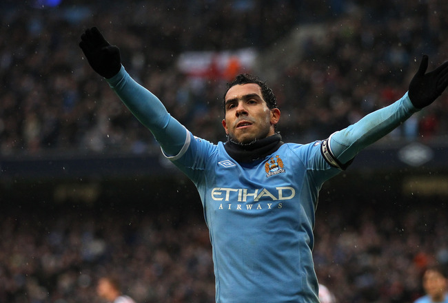 MANCHESTER, ENGLAND - FEBRUARY 05:  Carlos Tevez of Manchester City celebrates after scoring his third goal during the Barclays Premier League match between Manchester City and West Bromwich Albion at the City of Manchester Stadium on February 5, 2011 in
