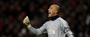 LIVERPOOL, ENGLAND - DECEMBER 06:   Pepe Reina of Liverpool shouts to his team mates during the Barclays Premier League match between Liverpool and Aston Villa at Anfield on December 6, 2010 in Liverpool, England. (Photo by Mark Thompson/Getty Images)