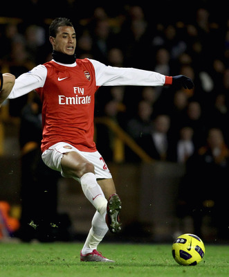 WOLVERHAMPTON, ENGLAND - NOVEMBER 10:  Marouane Chamakh of Arsenal (R) in action with Christophe Berra of Wolverhampton during the Barclays Premier League match between Wolverhampton Wanderers and Arsenal, at Molineux  on November 10, 2010 in Wolverhampto