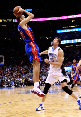 ORLANDO, FL - JANUARY 24:  Tayshaun Prince #22 of the Detroit Pistons attempts a shot over Hedo Turkoglu #15 of the Orlando Magic during the game at Amway Arena on January 24, 2011 in Orlando, Florida.  NOTE TO USER: User expressly acknowledges and agrees