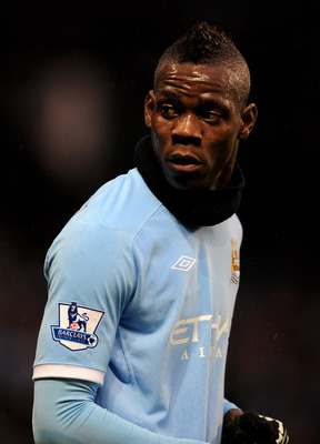 MANCHESTER, ENGLAND - DECEMBER 04:  Mario Balotelli of Manchester City looks on during the Barclays Premier League match between Manchester City and Bolton Wanderers at the City of Manchester Stadium on December 4, 2010 in Manchester, England.  (Photo by