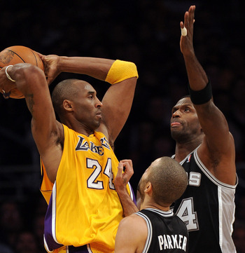LOS ANGELES, CA - FEBRUARY 03:  Kobe Bryant #24 of the Lakers is surrounded by Antonio McDyess #34 and Tony Parker #9 of the San Antonio Spurs Los Angeles during an 89-88 Spur win at Staples Center on February 3, 2011 in Los Angeles, California.  NOTE TO