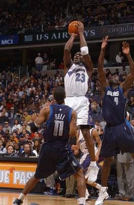 WASHINGTON - FEBRUARY 23:  Michael Jordan #23 of the Washington Wizards shoots against Raja Bell #11 and Michael Finley #4 of the Dallas Mavericks during the NBA game at MCI Center on February 23, 2003 in Washington, D.C.  The Mavericks won in overtime 10