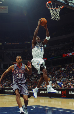 WASHINGTON - FEBRUARY 21:  Michael Jordan #23 of the Washington Wizards takes the ball to the basket past Kerry Kittles #30 of the New Jersey Nets during the NBA game at MCI Center on February 21, 2003 in Washington, D.C.  The Wizards won 89-86.  NOTE TO