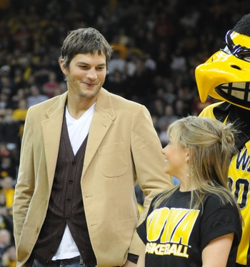 IOWA CITY, IA - DECEMBER 12: Olympic medalist Shawn Johnson (R) and actor Ashton Kutcher are honored during halftime of the Iowa-Iowa State college basketball game on December 12, 2008 at the University of Iowa in Iowa City, Iowa. Johnson and Kutcher, bot