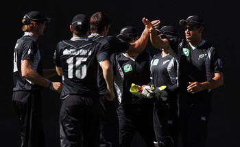 AUCKLAND, NEW ZEALAND - FEBRUARY 05:  Ross Taylor (R) of the Black Caps celebrates with Hamish Bennett after taking the wicket of Younis Khan of Pakistan during game six of the one day series between New Zealand and Pakistan at Eden Park on February 5, 20
