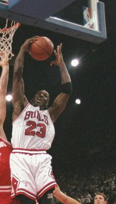 18 Oct 1997:  Guard Michael Jordan #23 of the Chicago Bulls grabs the rebound during an exhibition game between the Chicago Bulls and the Olympiakos during the McDonald''s Championship at the Palais  Omnisports De Paris-Bercy in Paris, France.  The Bulls