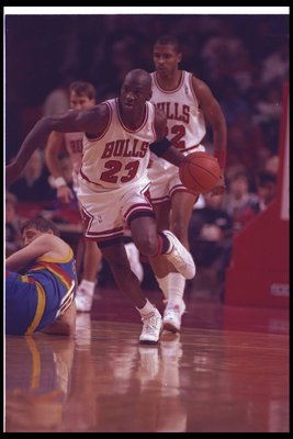 14 Nov 1992:  Guard Michael Jordan of the Chicago Bulls moves down the court during a game against the Denver Nuggets at the United Center in Chicago, Illinois. Mandatory Credit: Jonathan Daniel  /Allsport