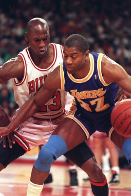 5 Jun 1991:  Magic Johnson of the Los Angeles Lakers shields the ball from Michael Jordan of the Chicago Bulls during game two of the 1991 NBA finals.   Mandatory Credit: Jonathan Daniel/ALLSPORT