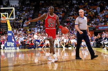 1989:  Michael Jordan #23 of the Chicago Bulls points and walks with the ball during the game.   Mandatory Credit: Tim DeFrisco  /Allsport