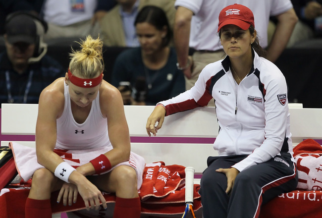 SAN DIEGO - NOVEMBER 06:  Bethanie Mattek-Sands (L) and captain Mary Joe Fernandez look on between a game against Flavia Pennetta of Italy during their Fed Cup final singles match at the San Diego Sports Arena on November 6, 2010 in San Diego, California.