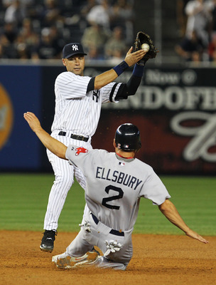NEW YORK - AUGUST 08:  Derek Jeter #2 of the New York Yankees makes the final out of the game securing a 7-2 win as Jacoby Ellsbury #2 of the Boston Red Sox slides during their game on August 8, 2010 at Yankee Stadium in the Bronx borough of New York City