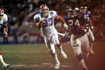 TAMPA, FL - JANUARY 27:  Running back Ottis Anderson #24 of the New York Giants carries the ball against linebacker Cornelius Bennett #97 of the Buffalo Bills during Super Bowl XXV at Tampa Stadium on January 27, 1991 in Tampa, Florida. The Giants defeate