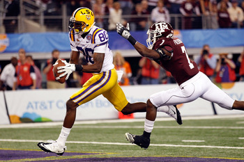 ARLINGTON, TX - JANUARY 07:  Terrence Toliver #80 of the Louisiana State University Tigers catches a touchdown pass over Terrence McCoy #7 of the Texas A&M Aggies during the AT&T Cotton Bowl at Cowboys Stadium on January 7, 2011 in Arlington, Texas.  (Pho