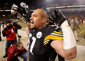 PITTSBURGH, PA - JANUARY 15:  Linebacker James Farrior #51 of the Pittsburgh Steelers celebrates after defeating the Baltimore Ravens 31-24 in the AFC Divisional Playoff Game at Heinz Field on January 15, 2011 in Pittsburgh, Pennsylvania.  (Photo by Grego