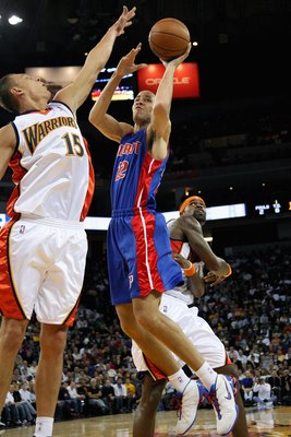 OAKLAND, CA - NOVEMBER 13:  Tayshaun Prince #22 of the Detroit Pistons goes up for a shot over Andris Biedrins #15 and Stephen Jackson #1 of the Golden State Warriors during the game on November 13, 2008 at Oracle Arena in Oakland, California.  The Piston