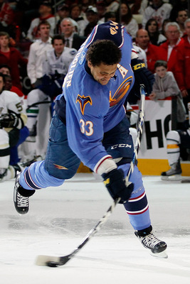 RALEIGH, NC - JANUARY 29:  Dustin Byfuglien #33 of the Atlanta Thrashers takes part in the hardest shot part of the Honda NHL SuperSkills competition part of 2011 NHL All-Star Weekend at the RBC Center on January 29, 2011 in Raleigh, North Carolina.  (Pho