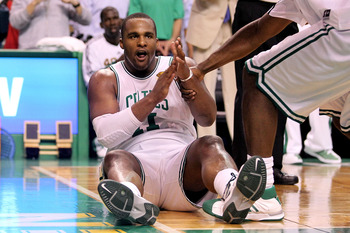 BOSTON - JUNE 10:  Glen Davis #11 of the Boston Celtics is helped up from the court during Game Four of the 2010 NBA Finals against the Los Angeles Lakers on June 10, 2010 at TD Garden in Boston, Massachusetts. NOTE TO USER: User expressly acknowledges an