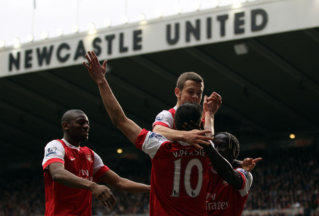 NEWCASTLE UPON TYNE, ENGLAND - FEBRUARY 05:  Robin Van Persie of Arsenal celebrates scoring the fourth goal during the Barclays Premier League match between Newcastle United and Arsenal at St James' Park on February 5, 2011 in Newcastle upon Tyne, England