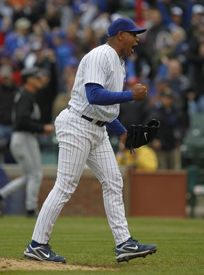 CHICAGO - MAY 12: Carlos Marmol #49 of the Chicago Cubs celebrates a win over the Florida Marlins at Wrigley Field on May 12, 2010 in Chicago, Illinois. The Cubs defeated the Marlins 4-3. (Photo by Jonathan Daniel/Getty Images)