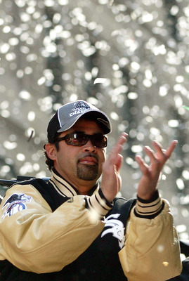 CHICAGO - OCTOBER 28:  Chicago White Sox manager Ozzie Guillen claps with fans as he rides atop a double-decker bus during a ticker-tape parade for the White Sox baseball team October 28, 2005 in downtown Chicago, Illinois. The Chicago White Sox won their