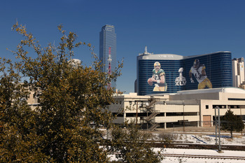 DALLAS, TX - FEBRUARY 5: General view of the downtown skyline with Super Bowl XLV art draped from the Omni Hotel on February 5, 2011 in Dallas, Texas. The Green Bay Packers will play the Pittsburgh Steelers in Super Bowl XLV on February 6, 2011 at Cowboys