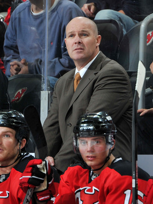 NEWARK, NJ - OCTOBER 16: John MacLean head coach of the New Jersey Devils watches the game action against the Boston Bruins during the second period at the Prudential Center on October 16, 2010 in Newark, New Jersey. The Bruins defeated the Devils 4-1. (P