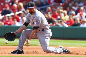 ST. LOUIS - OCTOBER 2: Todd Helton #17 of the Colorado Rockies mis plays a ground ball against the St. Louis Cardinals at Busch Stadium on October 2, 2010 in St. Louis, Missouri.  The Cardinals beat the Rockies 1-0 in 11 innings.  (Photo by Dilip Vishwana