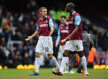 LONDON, ENGLAND - FEBRUARY 06:  Gary O'Neill and Carlton Cole of West Ham United walk off the pitch dejected after defeat in the Barclays Premier League match between West Ham United and Birmingham City at the Boleyn Ground on February 6, 2011 in London,