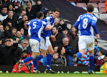 LONDON, ENGLAND - FEBRUARY 06:  Nikola Zigic of Birmingham City celebrates with teammates Roger Johnson (L) and Craig Gardner after scoring the opening goal during the Barclays Premier League match between West Ham United and Birmingham City at the Boleyn