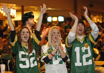 GREEN BAY, WI - FEBRUARY 06: Green Bay Packers fans Kelsey Brabender, Daisy Gresen, and Dylan Palchik react to a play while watching the Super Bowl at Stadium View Bar on February 6, 2011 in Green Bay, Wisconsin.  (Photo by Matt Ludtke/Getty Images)