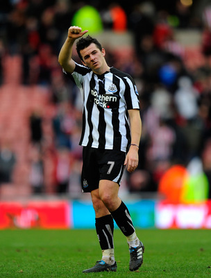 SUNDERLAND, ENGLAND - JANUARY 16:  Newcastle player Joey Barton acknowledges the fans during the Barclays Premier League match between Sunderland and Newcastle United at Stadium of Light on January 16, 2011 in Sunderland, England.  (Photo by Stu Forster/G