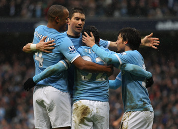 MANCHESTER, ENGLAND - FEBRUARY 05:  Carlos Tevez of Manchester City celebrates with team mates after scoring his second goal during the Barclays Premier League match between Manchester City and West Bromwich Albion at the City of Manchester Stadium on Feb