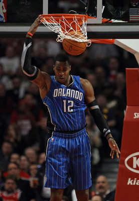 CHICAGO, IL - JANUARY 28: Dwight Howard #12 of the Orlando Magic dunks the ball for two of his game-high 40 points against the Chicago Bulls at the United Center on January 28, 2011 in Chicago, Illinois. The Bulls defeated the Magic 99-90. NOTE TO USER: U