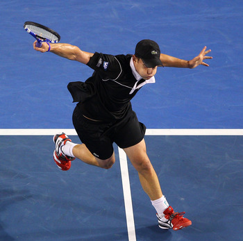 MELBOURNE, AUSTRALIA - JANUARY 23:  Andy Roddick of the United States of America plays a backhand in his fourth round match against Stanislas Wawrinka of Switzerland during day seven of the 2011 Australian Open at Melbourne Park on January 23, 2011 in Mel