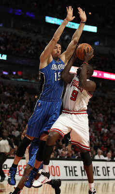 CHICAGO, IL - JANUARY 28: Loul Deng #9 of the Chicago Bulls puts up a shot against Hedo Turkoglu #15 of the Orlando Magic at the United Center on January 28, 2011 in Chicago, Illinois. The Bulls defeated the Magic 99-90. NOTE TO USER: User expressly ackno
