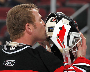 NEWARK, NJ - FEBRUARY 01:  Goalie Martin Brodeur #30 of the New Jersey Devils kisses the back of his mask before the start of an NHL hockey game against the Ottawa Senators at the Prudential Center on February 1, 2011 in Newark, New Jersey.  (Photo by Pau