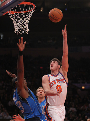 NEW YORK, NY - FEBRUARY 02:  Danilo Gallinari #8 of the New York Knicks shoots the ball over Brendan Haywood #33 of the Dallas Mavericks at Madison Square Garden on February 2, 2011 in New York City. NOTE TO USER: User expressly acknowledges and agrees th