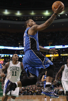 BOSTON, MA - FEBRUARY 06:  Jameer Nelson #14 of the Orlando Magic heads for the basket past Glen Davis #11 of the Boston Celtics on February 6, 2011 at the TD Garden in Boston, Massachusetts. The Celtics defeated the Magic 91-80. NOTE TO USER: User expres
